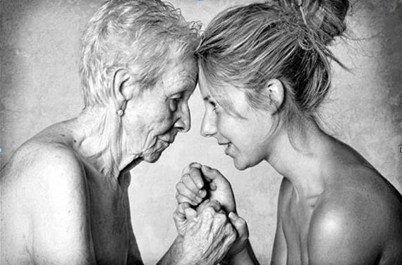 Aging mother and daughter in touching moment